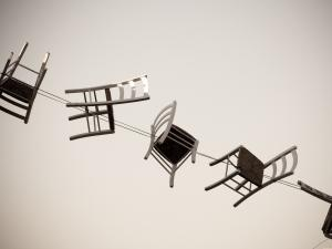 Chairs_in_the_air_Photo by Federica Campanaro on Unsplash