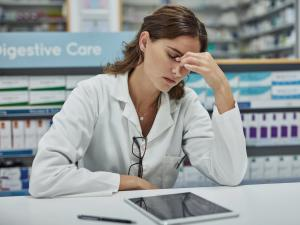 Stressed with headache pharmacist